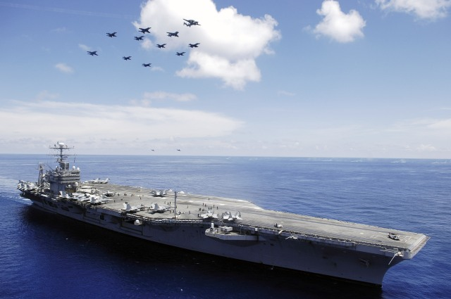 US_Navy_060508-N-4166B-030_The_Nimitz-class_aircraft_carrier_USS_Abraham_Lincoln_CVN_72_and_aircraft_assigned_to_Carrier_Air_Wing_Two_CVW-2_perform_an_aerial_demonstration_in_the_South_China_Sea